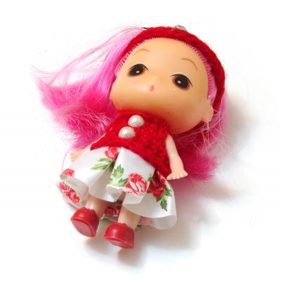 Куколка в красной кофточке
