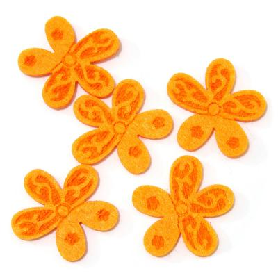 Цветочек из оранжевого фетра