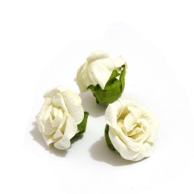 Маленькие головки роз из бумаги